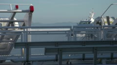 Ferry passing framed by railing Stock Footage
