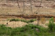 Stock Photo of Dilapidated suspension bridge - historical landmark in the desert