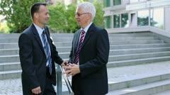 Two businessmen talking outside Stock Footage