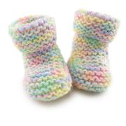 Baby booties in multi coloured yard Stock Photos