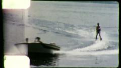 BOAT PULLS MAN TO SHORE Waterski 1960 (Vintage Old Film Home Movie) Stock Footage