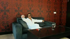 Cool guy on couch V2 - HD Stock Footage