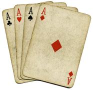 four old vintage dirty aces poker cards, isolated over white. - stock photo