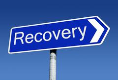 signpost along the road to recovery. - stock photo