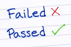 Failed and passed written on white paper. Stock Photos