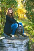 girl saddle lion statuary - stock photo