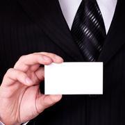 businessman show blank card - stock photo