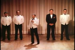 Cruise ship staff on stage for introductions at Captain's cocktail party Stock Footage