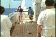 People playing shuffleboard on a cruise ship in the Atlantic Ocean Stock Footage