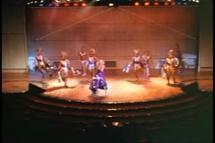 Stage show on a cruise ship, glitzy, wide front shot of dancers Stock Footage