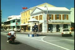 The Birdcage, Hamilton, Bermuda, black policeman directing traffic Stock Footage