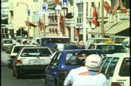 Traffic on Front Street, Hamilton, Bermuda, 1993, very busy, crushed shot Stock Footage