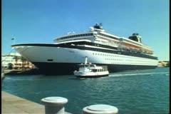 Cruise ship, MV Horizon at dock in Hamilton, Bermuda, ferry boat in front - stock footage