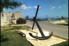 Stone wall, huge anchor, Royal Naval Dockyard at King's Wharf, Bermuda Stock Footage