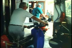 Moped, motor scooter, drivers wheel bikes off ferry boat in Bermuda Stock Footage