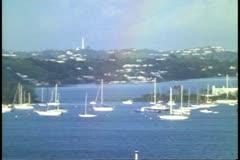 Cruise ship, POV entering harbor at Hamilton, Bermuda, lighthouse, dawn Stock Footage
