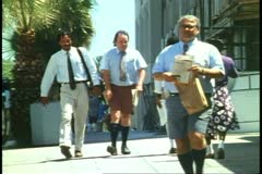People in Bermuda shorts, Hamilton, Bermuda, 1993 Stock Footage