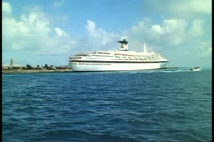 Stock Video Footage of POV ferry boat passing cruise ship, SS Meridian, King's Wharf, Bermuda