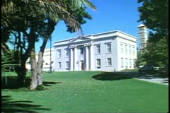 Cabinet Building, Hamilton, Bermuda, green lawn in front, classical front Stock Footage