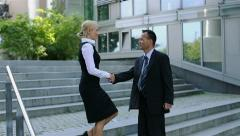 Business man and woman meet and greet Stock Footage