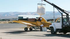 Aircraft crop duster loading seed wildfire fast HD 3428 Stock Footage