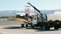 Aircraft loading seed for wildfire burn planting HD 3428 Stock Footage