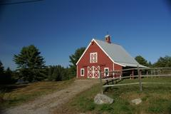 new england red barn and fence - stock photo
