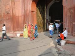 Visitors approach the red fort's main gate Stock Photos