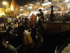 Stock Photo of boatloads of tourists and hindu pilgrims attend aarti evening services