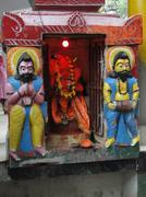 Stock Photo of temple guardian statues outside shiva temple