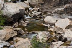 Water falls in the Colorado Rockies over granite - 3 Stock Photos