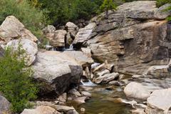 Water falls in the Colorado Rockies over granite - 2 - stock photo