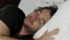 Man goes to sleep - HD Stock Footage