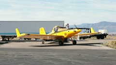 Aircraft yellow crop duster loading seeds for wildfire HD 3442 Stock Footage