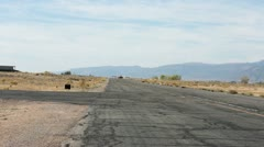 Aircraft yellow landing taxi off runway Stock Footage