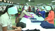 Stock Video Footage of Asian Garment Industry Workers: Wide Angle workers at long table