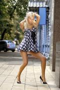 Beautiful girl in black shoes Stock Photos