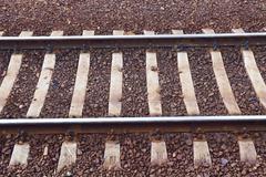 Closeup of rail track Stock Photos