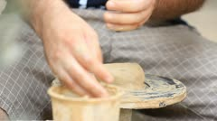 Potter's wheel Clay workshop creative occupation profession ceramics craft pot Stock Footage