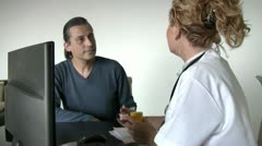 Stock Video Footage of Female doctor consulting with  patient