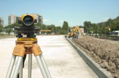 Surveying equipment to infrastructure construction project Stock Photos