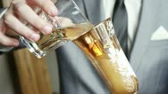 Groom pours champagne Stock Footage