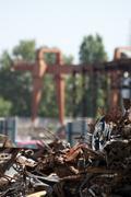 pile of scrap iron and crane - stock photo