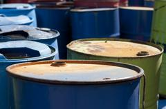 old colored barrels for oil products - stock photo