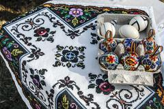 Painted eggs and tablecloth embroidered romanian traditional Stock Photos