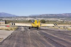 Agriculture aircraft crop duster taxi takeoff runway.jpg Stock Photos