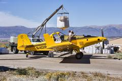 Aircraft loading with fuel and seeds for wildfire recovery.jpg Stock Photos