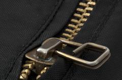 Closed yellow metal zipper Stock Photos