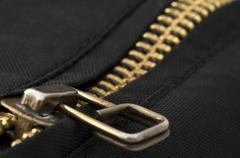 closed yellow metal zipper - stock photo