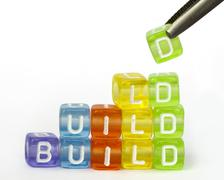 Text build on colorful wooden cubes Stock Photos